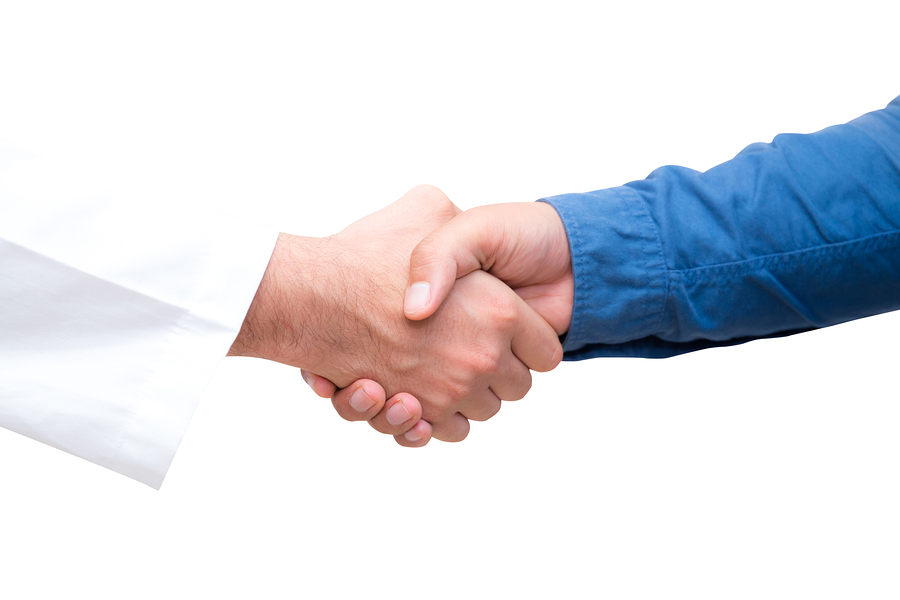 handshake with patient